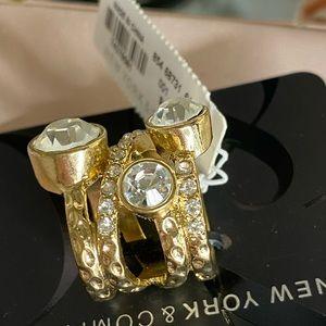 Gold statement ring.